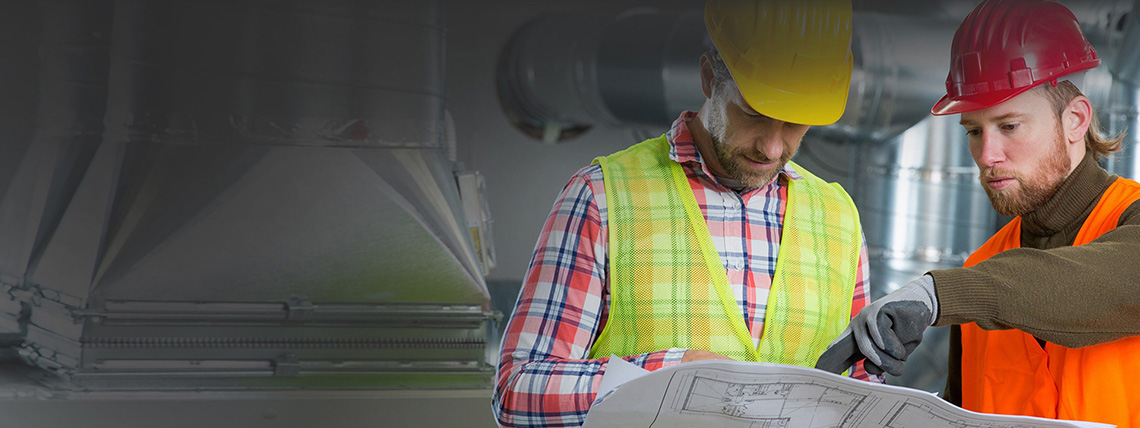 photo of two men discussing manufacturing planning